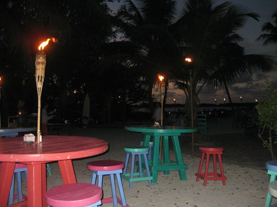 Morada Bay: Bar Tables W/ Tiki Torches Lighted