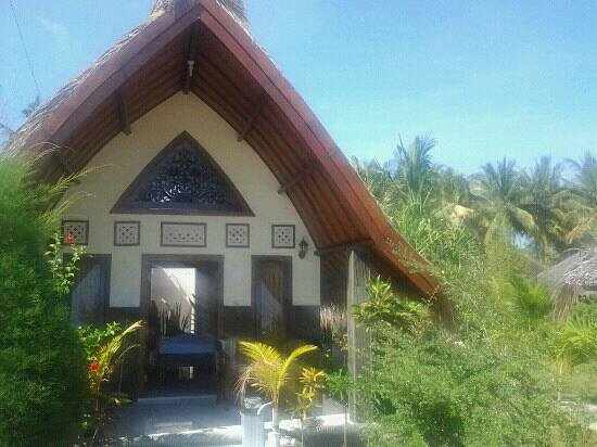 Pelangi Cottages And Restaurant : bungalow face à la mer