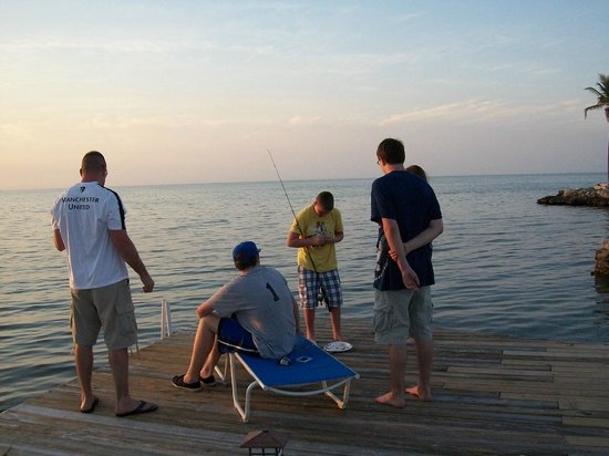 Tranquility Bay Beach House Resort: Fishing from the dock and enjoying the sunset