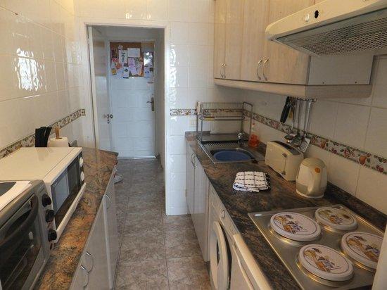 Las Vistas: part view of kitchen with washing machine