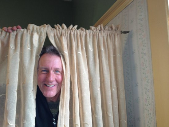 Emerson Guest House: Bill hanging new drapes for you in the Hunt Room!