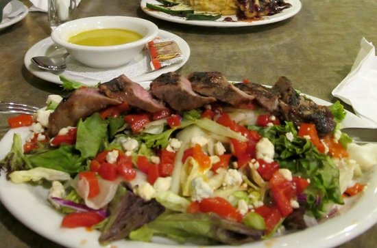 Juicy's Famous River Cafe: Adobe steak salad, spring greens, roasted red peppers, blue cheese and orange cilantro dressing