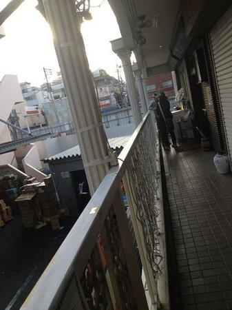 Beer Bar Ushitora: Narrow balcony looking back to the station