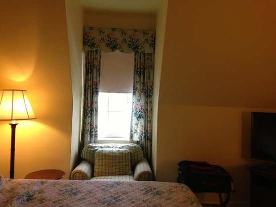 The Otesaga Resort Hotel: The room is decent sized, but the small window makes it feel small