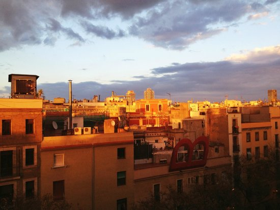 Allada Apartments: sunset from roofgarden