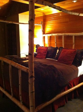 Church Landing at Mill Falls: King-sized bed with the birch frame.