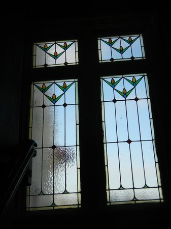 James Bay Inn Hotel, Suites & Cottage: One of the original stained glass windows located in the stairway from the lobby.