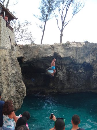 Island Routes Caribbean Adventures - Jamaica: Rick's Cafe - tourist jumping