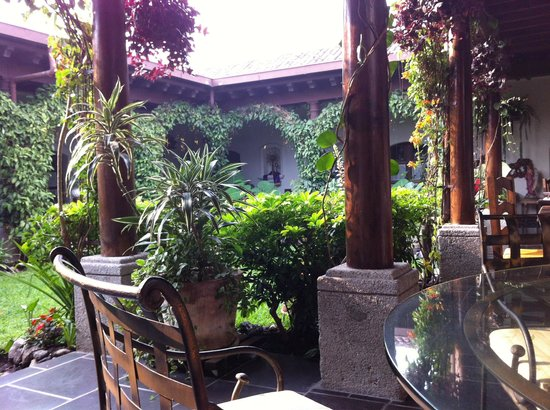 Hotel la Catedral: A table in the seating area around the courtyard.