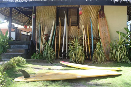 The Boardwalk at Cloud 9: Surfboards for rent inside the inn.