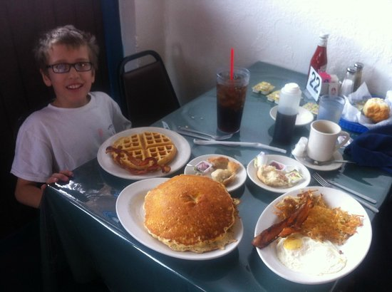 Mr. Tim's Country Kitchen: Getting ready to chow down...  Yes, there are two pancakes and they are that big!