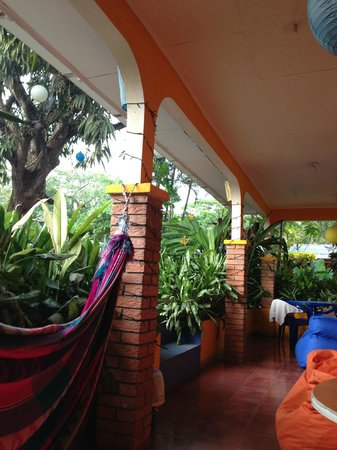 Buddha House Boutique Hostel: view of common terrace in front of shared rooms