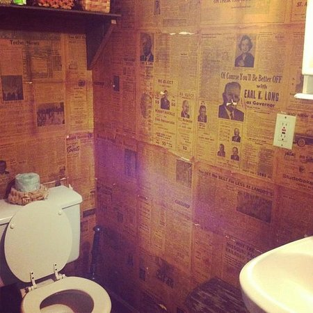 Bayou Cabins: Cabin 1. Read old newspapers while you do your business!