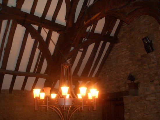 The King's Head : an old chandelier to match the medieval ceiling...