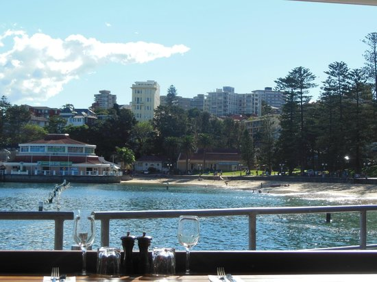 Hugos Manly : view of little beach next to wharf from our table