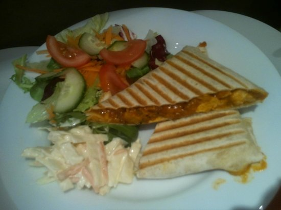Cafe Divine: Hot chicken tikka wrap with salad and homemade coleslaw