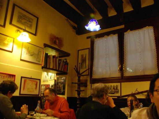 Osteria Al Diavolo E L'acquasanta : Cozy dining room, quirky ornaments