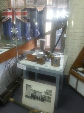 Cowra Visitor Information Centre: display of memorabilia from Cowra P.O.W Camp