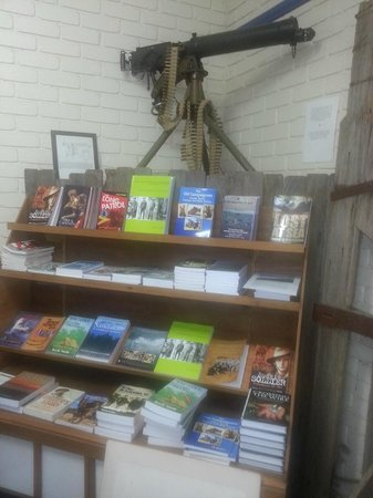 Cowra Visitor Information Centre: Vickers gun and our impressive array of war books