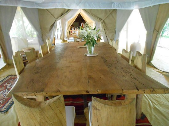 Naibor Camp: One of many dining tables. Dinner by lantern is the norm.
