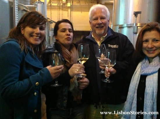 Lisbon Stories: Our guide Catia, Silvia, Steve and Karen enjoying a wine tasting, directly from the vats!
