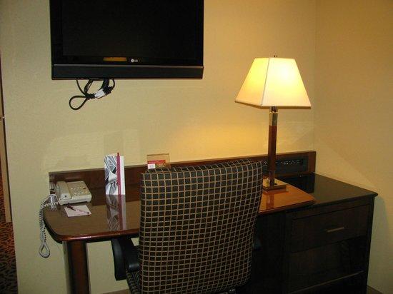 Augusta Marriott at the Convention Center: Desk in living room; TV above desk