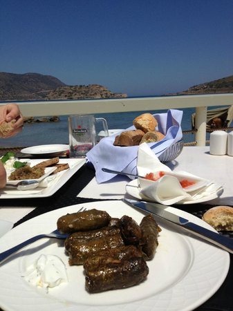 Domes of Elounda, Autograph Collection: Eating stuffed vine leaves for €6 on the hotel jetty.