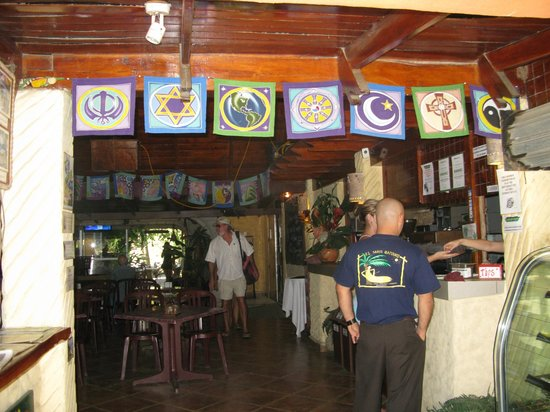El Sano Banano Restaurant : Spiritual flags at the entrance