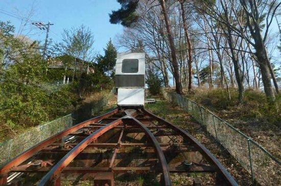 Hishino Onsen Tokiwakan: 登山電車で露天風呂に行きます