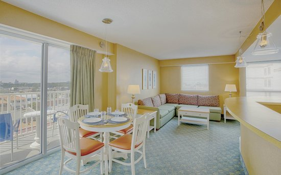 Boardwalk Resort Hotel and Villas: Oceanfront suite features dining area, bedroom, kitchen and living room.