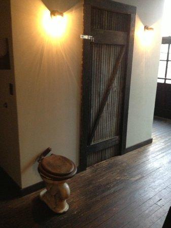 Hillbilly Tea: Toilet decor in the hallway