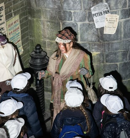 Dickens World: Tour Guide Blushing Bonnie with a School Group