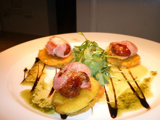The Coore Arms: Dates wrapped in bacon on courgette fritters with rocket oil and hot honey and mustard dressing