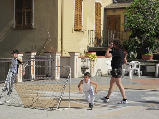 Ca' de Capun Camere Franco : Kids playing football on the town plaza