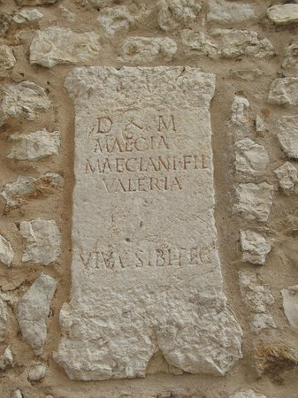 La Cathedrale Notre-Dame de la Nativite de Vence : Ancient Roman funeral stones dedicated to everyday Ventium (Vence) people in the cathedral wall