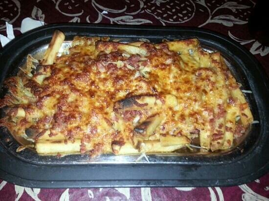 Friday's 1890 Seafood: one of the best bacon Cheese fries ever