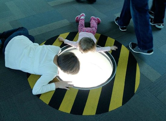 Saint Louis Science Center: Looking at the window in the floor to see the cars on the highway below