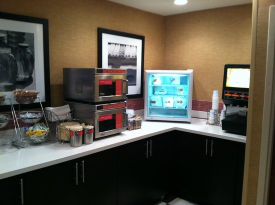 Hampton Inn Raleigh - Capital Blvd. North : breakfast area with refrigerated heat-n-eat sandwiches