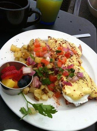 Eggs Benedict topped with pico de gallo