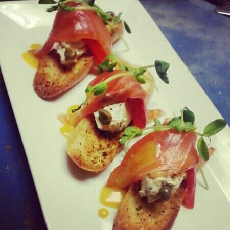 Norma Jean's: smoked salmon herbed cream cheese capers prea sprouts and butternut cider vinaigrette