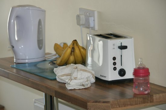 Ballycommon House: microwave toaster kettle electric hob and oven.  Dining area to fit  6 to 8 people.