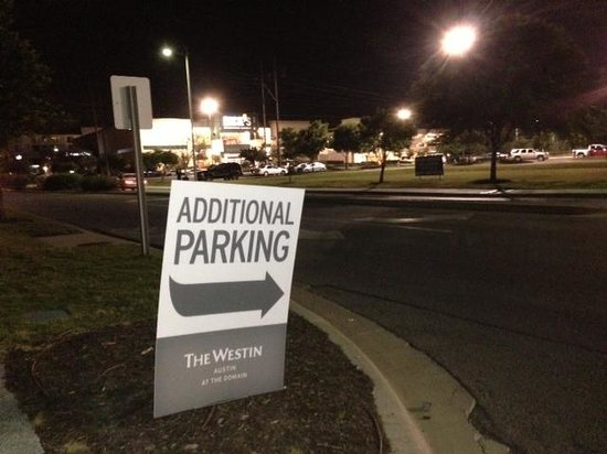 The Westin Austin at The Domain: Parking sign directing guests to park at Macy's across street