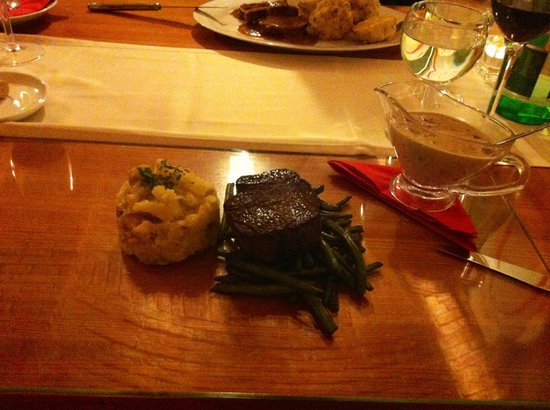 Tulip Restaurant : Young Bull Steak (200g) with green beans and mashed potatoes and a side of mushroom sauce