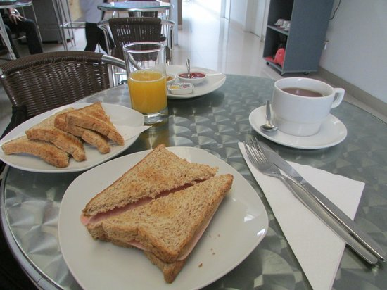 3B Barranco's - Chic and Basic - B&B: breakfast of toast, hot ham and cheese,oj and tea