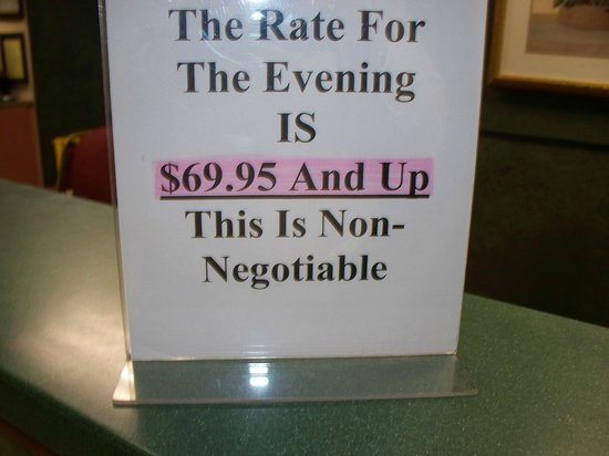 Red Roof Inn & Suites Newnan: Sign on desk that added $20.00 to our crappy stay