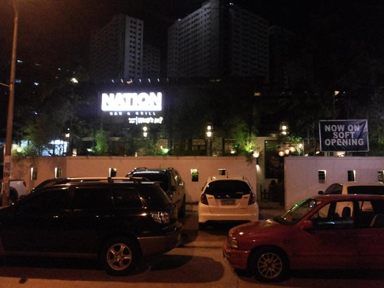 Nation Bar & Grill: Night shot from the outside.