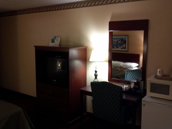 Super 8 Greenville : A shot of the desk, fridge, microwave, and TV