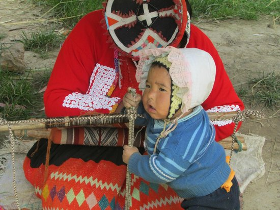 """Awamaki: little boy """"assisting"""" with the weaving"""