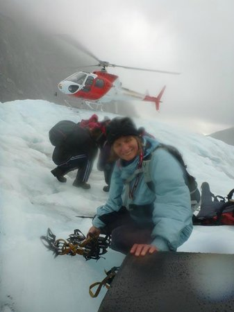 Fox Glacier Guiding: fitting crampons on the glacier