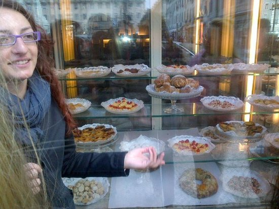 Inside Lisbon Tours: our guide pointing out some good pastries